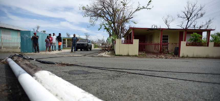 Residents of the Santa Ana community wait for a delivery of supplies from soldiers and National Guard in the aftermath of Hurricane Maria in Guayama, Puerto Rico on Oct. 5.