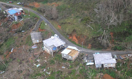 Wrecked houses are shown in Jayuya, Puerto Rico on Saturday.