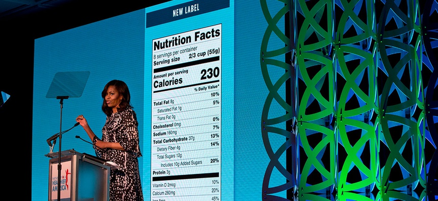 Michelle Obama announces a makeover for food nutrition labels with calories listed in bigger, bolder type and a new line for added sugars in Washington in 2016.