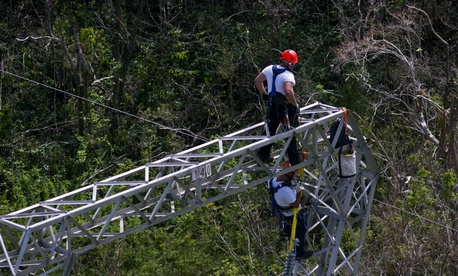 Whitefish Energy Holdings workers restore power lines damaged by Hurricane Maria in Barceloneta, Puerto Rico on Oct. 15.
