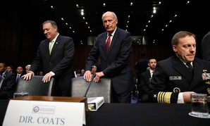 CIA Director Mike Pompeo, Director of National Intelligence Dan Coats, and National Security Agency Director Adm. Michael Rogers take their seats on Capitol Hill in May.