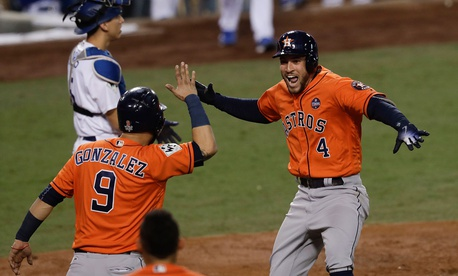 George Springer and Marwin González celebrate after Springer's home run Thursday night.