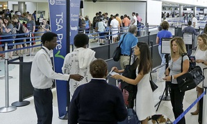 Travelers stand in line as they prepare to be screened a Transportation Security Administration checkpoint at Fort Lauderdale-Hollywood International Airport, Friday, May 27, 2016.