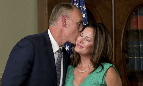 Interior Secretary Ryan Zinke kisses his wife Lolita after taking the oath of office on March 1.
