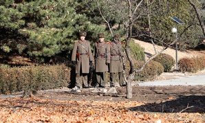 North Korean soldiers keep watch where a North Korean defector crossed the border on November 13, at the truce village of Panmunjom inside the demilitarized zone, in South Korea, on November 27.