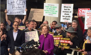 Sen. Elizabeth Warren, D-Mass., spoke to a crowd of protesters outside CFPB headquarters on Tuesday before the court ruled.