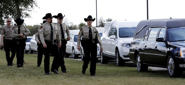 Mourners arrive at a funeral for members of the Holcombe family who were killed when an Air Force veteran with a violent history opened fire at the Sutherland Springs Baptist Church, killing 26.
