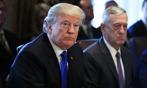 President Trump and Defense Secretary Jim Mattis (right) listen to a reporter's question during the Wednesday Cabinet meeting.