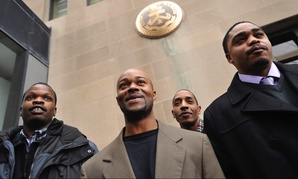 "Terrill Swift, second from right, posing with the rest of the ""Englewood Four"" in 2012, having been exonerated in a 1994 rape and murder with new DNA evidence. Swift's photo is still on Mugshots.com."