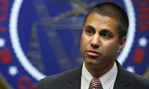 FCC Chairman Ajit Pai arrives for an FCC meeting where they will vote on net neutrality, Thursday, Dec. 14, 2017.