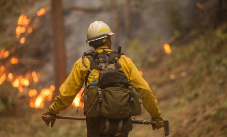 A firefighter walks near the North Umpqua River in Oregon in September.