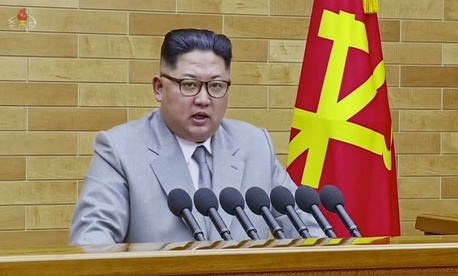 Kim Jong Un speaks in his annual address in undisclosed North Korean location in a still from KRT.