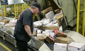 Packages are arranged at the main post office in Omaha, Neb., during the holidays. USPS was Americans' favorite federal agency on a recent poll.