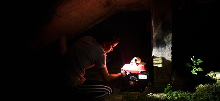 Karina Santiago Gonzalez works on a small power plant in Morovis, Puerto Rico on Dec. 21.