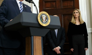 Ivanka Trump watches as President Donald Trump speaks during an event on federal regulations in the Roosevelt Room of the White House on Dec. 14.