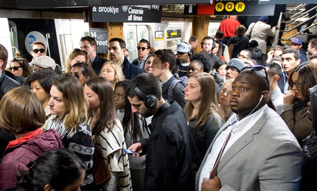 Commuters crowd a platform after exiting the L train in the Union Square subway station in New York in May.