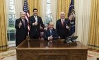 President Trump celebrates the passage of the Tax Cuts Act with Vice President Mike Pence, Senate Majority Leader Mitch McConnell, and Speaker of the House Paul Ryan on Dec. 20.