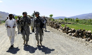U.S. Navy engineers talk to Afghan officials in Khost Province, Afghanistan.