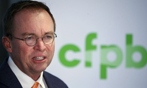 New CFPB Director Mick Mulvaney speaks during a news conference.