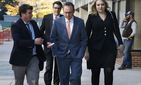 Mick Mulvaney arrives at the Consumer Financial Protection Bureau shortly after his controversial appointment.