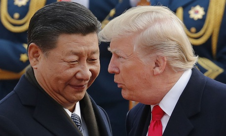 President Trump speaks with Chinese President Xi Jinping during a welcome ceremony at the Great Hall of the People in Beijing in November.
