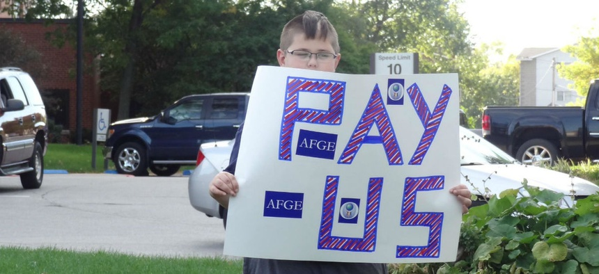 An AFGE activist in Iowa protests the 2013 government shutdown.