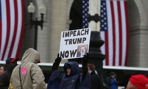 A protestor shows a sign during a rally in D.C. in 2017.