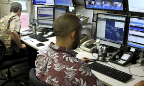 Hawaii Emergency Management Agency officials work at the department's command center in Honolulu