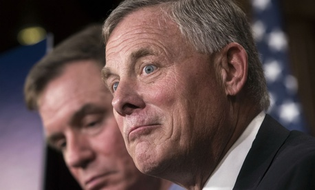 Senate Select Committee on Intelligence Chairman Richard Burr, R-N.C., right, and Vice Chairman Mark Warner, D-Va., left, oppose a provision that allows agencies to reprogram funds without telling Congress.