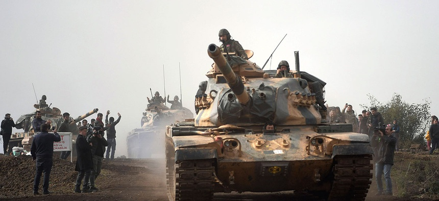 Turkish army tanks leaving Hassa, Hatay, Turkey, and heading for Afrin, an enclave in northern Syria controlled by U.S.-allied Kurdish fighters, on Jan. 22, 2018.