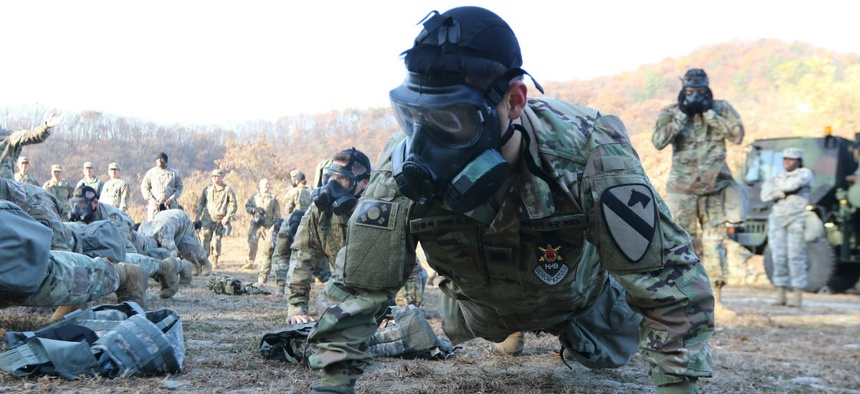 Soldiers demonstrate mission oriented protective posture (MOPP) gear change during chemical, biological, radiological and nuclear training at Camp Casey/Hovey, Republic of Korea in November.