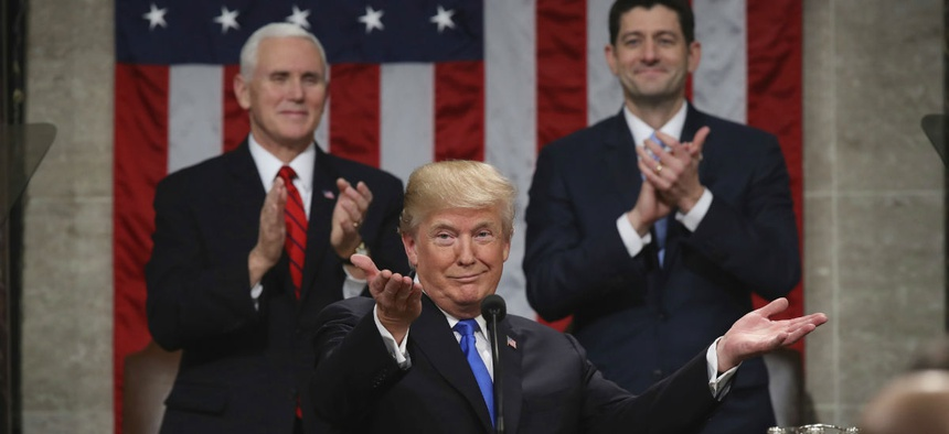 President Donald Trump gestures as delivers his first State of the Union address.