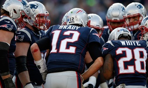The Patriots huddle during a game in November.