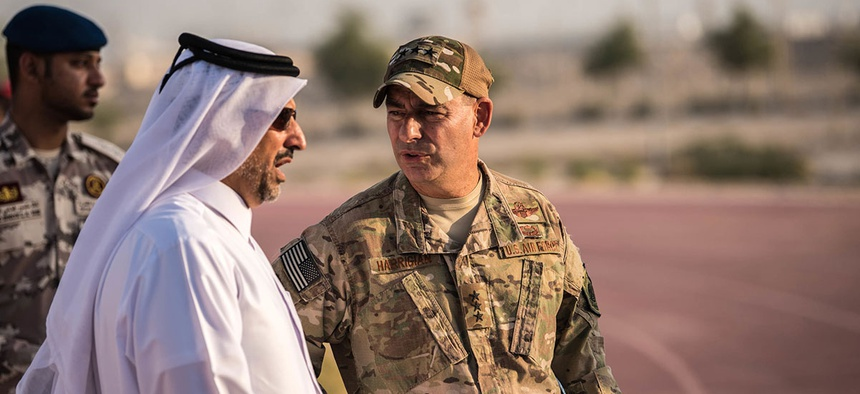 Lt. Gen. Jeffrey Harrigan, commander of the U.S. Air Forces Central Command, speaks with a Qatari Emiri Air Force leader at the QEAF Family Cultural Exchange at Al Udeid Air Base in December.