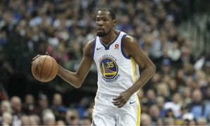 Golden State Warriors forward Kevin Durant dribbles during the first half of an NBA basketball game against the Dallas Mavericks on Jan. 3.