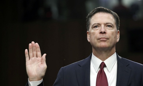 Former FBI Director James Comey is sworn in during a Senate Intelligence Committee hearing in June 2017.