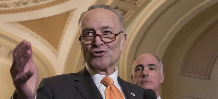 Senate Minority Leader Chuck Schumer, D-N.Y., speaks to reporters Tuesday.