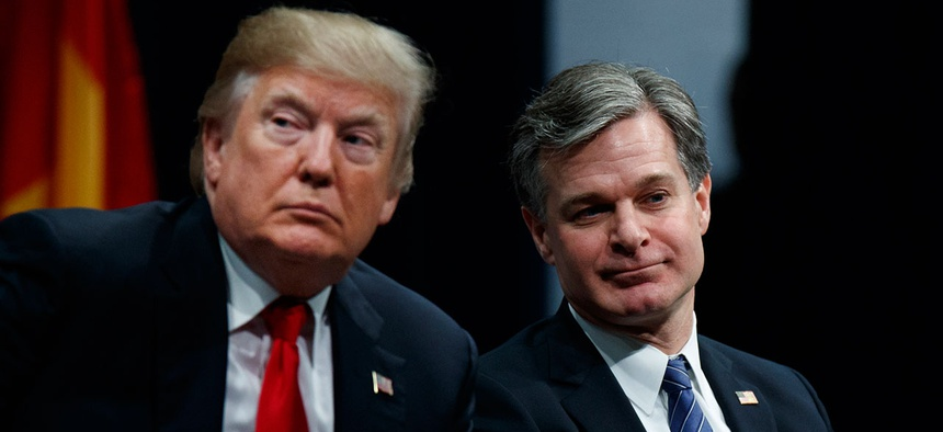 Donald Trump sits with FBI Director Christopher Wray in December.