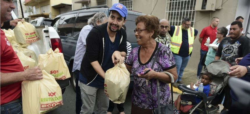 Actor and composer of Puerto Rican descent Lin-Manuel Miranda distributes food to victims of Hurricane Maria in November.