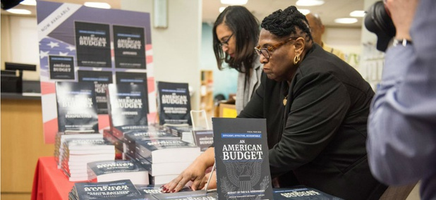 Federal workers put out copies of the Trump administration's FY2019 budget proposal.