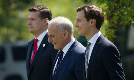 White House aides Rob Porter (left) and Jared Kushner (right) flank Chief of Staff Gen. John Kelly while heading to board Marine One, Friday, August 4, 2017.