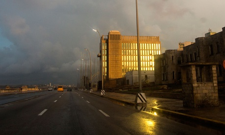 Rays from the setting sun shine on the facade of the United States Embassy, in Havana in October.