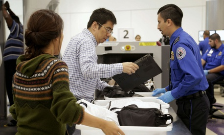 Passengers from international flights pass through a TSA checkpoint at Los Angeles International Airport.