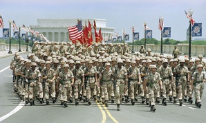 Troops march across the Memorial Bridge towards the Pentagon during 1991 National Victory Celebration Parade in Washington. It was the largest U.S. military parade since World War II.