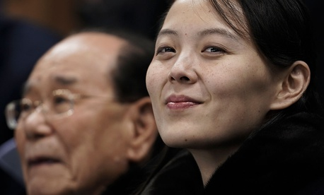 Kim Yo Jong, sister of North Korean leader Kim Jong Un, right, and North Korea's nominal head of state Kim Yong Nam, wait for the start of the preliminary round of the women's hockey game between Switzerland and the combined Koreas at the Winter Olympics.