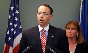 Rod Rosenstein, left, speaks as U.S. Attorney for the Western District of Washington Annette L. Hayes looks on at a news conference giving an update on the unsolved 2001 slaying of a federal prosecutor on Wednesday.