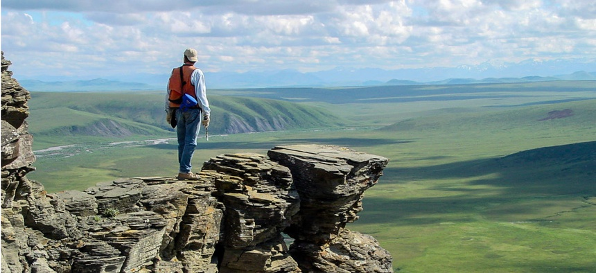 A geologist with the U.S. Geological Survey on​ an o​utcrop of Nanushuk Formation, Tuktu Bluff​, Alaska.