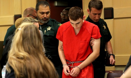 Nikolas Cruz appears in court for a status hearing before Broward Circuit Judge Elizabeth Scherer Monday, Feb. 19, in Florida.