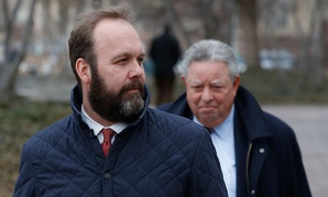 Rick Gates, left, with his lawyer Tom Green, depart Federal District Court, Wednesday, Feb. 14, in Washington.