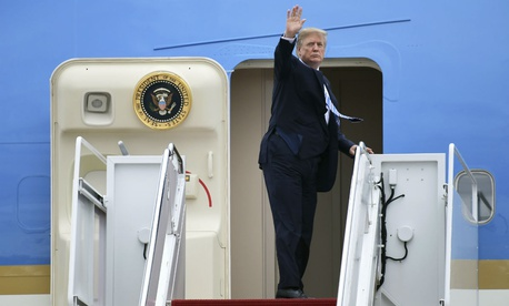 President Trump waves from the steps of Air Force One as he leaves for Mar-a-Lago earlier this month.